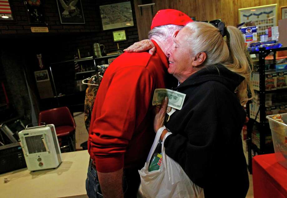 Carol Hefty hugs Secret Santa after he gave her a $100 dollar bill while she was looking for supplies at a temporary supply house at the Oakwood Heights VFW Post 9587 in the boro of Staten Island, New York, N.Y., Thursday, Nov. 29, 2012. The wealthy philanthropist from Kansas City, Mo. Secret Santa distributed $100 dollar bills to needy people at several locations in Elizabeth, N.J. and Staten Island. Photo: Rich Schultz, AP / FR27227 AP