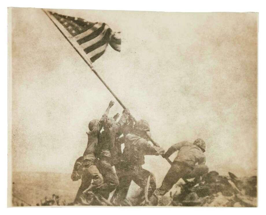 Joe Rosenthal, American (1911–2006), Old Glory Goes Up on Mount Suribachi, Iwo Jima, February 23, 1945, gelatin silver print, Photo: The Museum Of Fine Arts, Houston / San Antonio Express-News