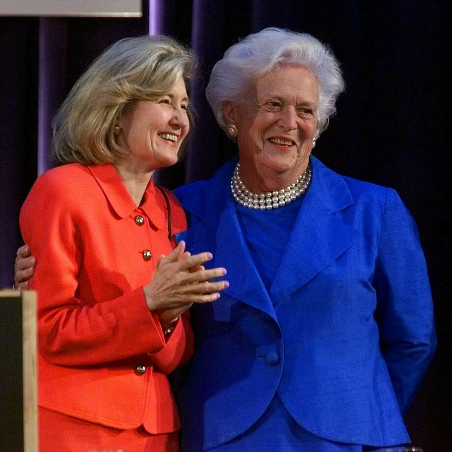 Former first lady Barbara Bush hugs Sen. Kay Bailey Hutchison before the start of the Republican Women Leaders Forum dinner at the Ronald Reagan International Trade Center in Washington, Tuesday, May 11, 1999. (Doug Mills / The Associated Press) Photo: DOUG MILLS, AP / AP