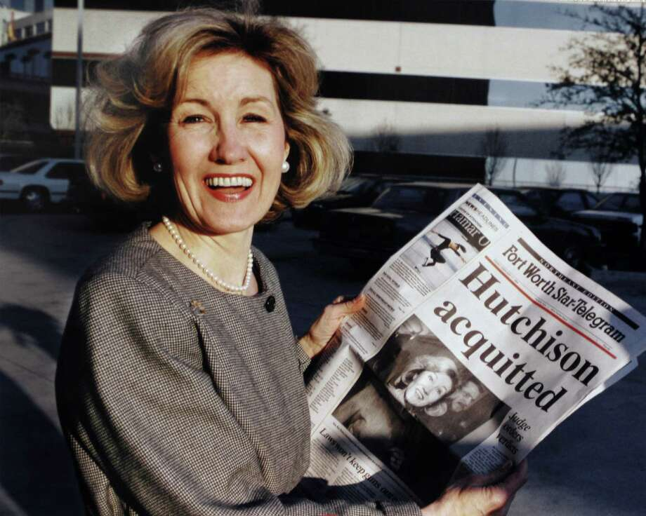 Sen. Kay Bailey Hutchison holds the Fort Worth Star-Telegram after she was acquitted Feb. 11, 1994. (Ron Heflin / The Associated Press) Photo: RON HEFLIN, AP / AP