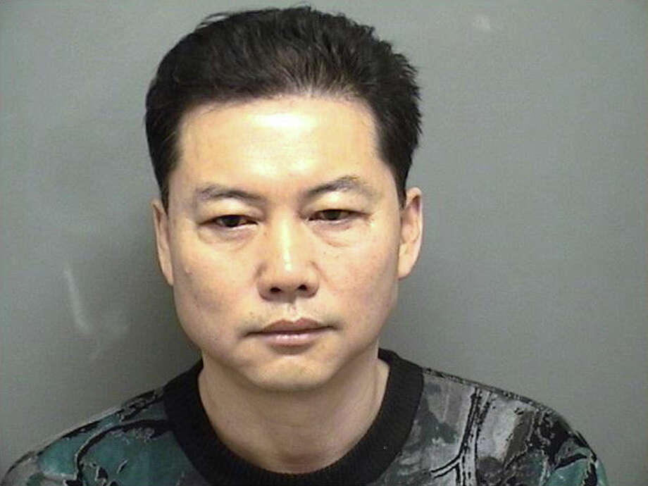 Fu Xu, a 49, from Elmhurst, N.Y.  was charged with promoting prostitution, permitting prostitution and three counts of employing unlicensed massage therapists. Photo: Contributed