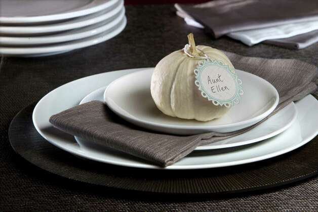 Dark linens provide contrast to white dinnerware. Photo: Tammy Ljungblad, MBR / Kansas City Star