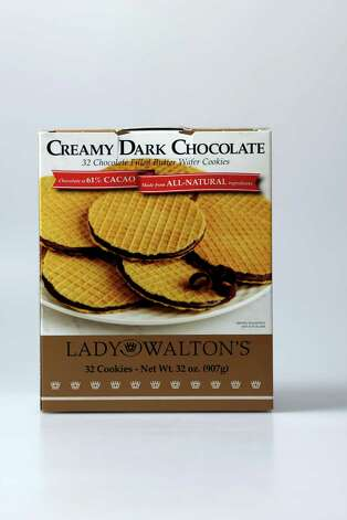 Hostess Gifts including Cranberry Almond Thins, Creamy Dark Chocolate Wafer Cookies, Mexican Chocolate and salami's flavored with wine. Photo: Helen L. Montoya, San Antonio Express-News / ©SAN ANTONIO EXPRESS-NEWS