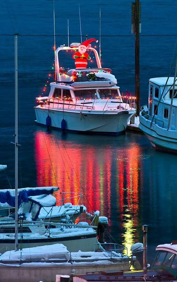 Deck the hulls: In Juneau's Aurora Harbor, the yachting set is already putting up the Christmas lights on the marina power boats. Photo: Michael Penn, Associated Press