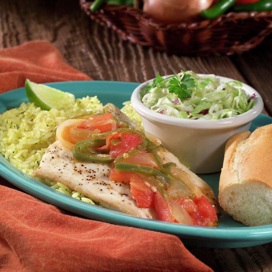 Light House Fish served with rice, coleslaw and a baguette from Sea Island Shrimp House