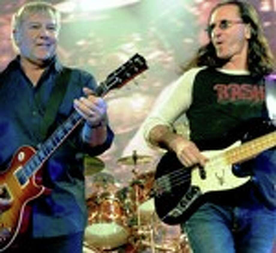Rush -- Alex Lifeson (left), Geddy Lee and Neil Peart (back) -- performs at the MGM Grand Garden Arena during a stop of the band's Time Machine Tour August 14, 2010 in Las Vegas, Nevada.