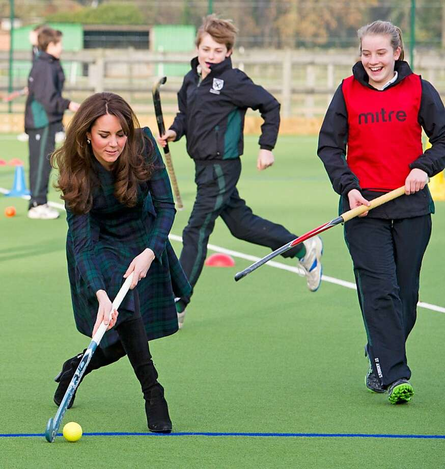 Duchess or Queen of Clubs? Even in high heels, Catherine plays a mean game of field hockey at St. Andrew's School in Pangbourne, Berkshire. The Duchess of Cambridge scrimmaged with members of the school's hockey team, which she played for during her time as a pupil at the school from 1986 to 1995. Photo: WPA Pool, Getty Images