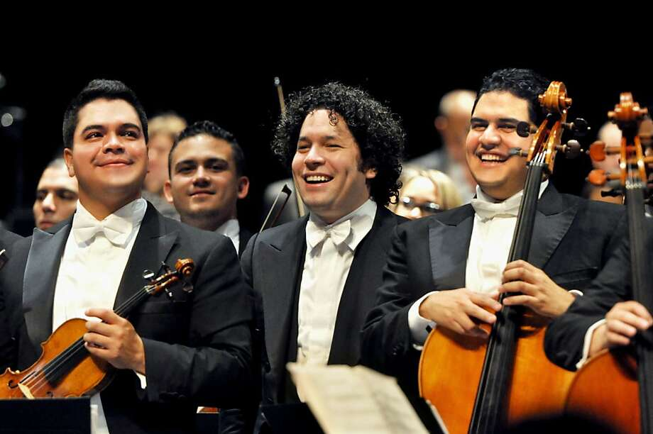 Alirio Vegas (left), Gustavo Dudamel and Aimon Mata of the Simón Bolívar orchestra at Zellerbach Hall on Thursday. Photo: Peg Skorpinski