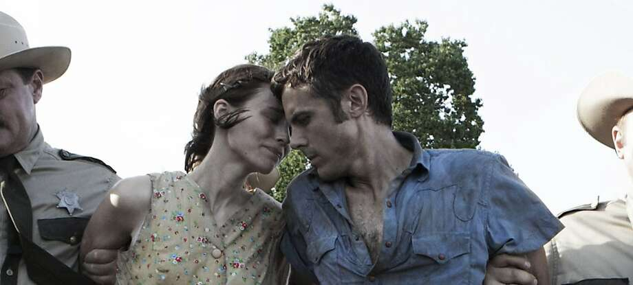 "Rooney Mara (left) and Casey Affleck star in David Lowery's ""Ain't Them Bodies Saints."" Photo: Steve Dietl, Associated Press"