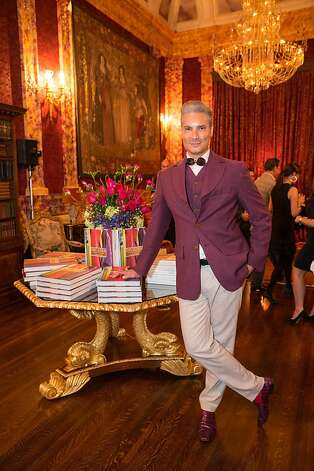"Nov. 29: Vintage fashion guru Cameron Silver, resplendent in Vivienne Westwood and a silver coif, launches his ""Decades"" tome at a party hosted by Vanessa and Billy Getty. Photo: Drew Altizer Photography"