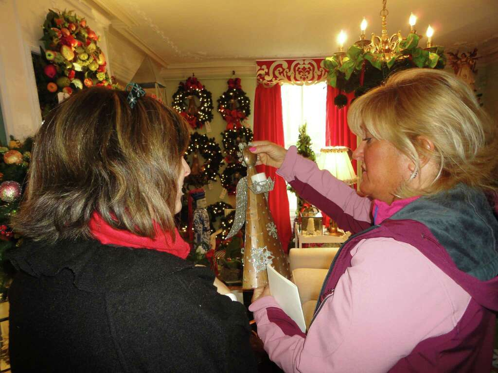 Lisa Ferrio of Fairfield shows an angel Christmas decoration to Linda  Moore, also of Fairfield