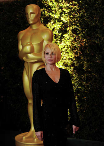 Actress Ellen Barkin arrives at the Academy of Motion Picture Arts and Sciences' 3rd Annual Governors Awards at the Hollywood & Highland Grand Ballroom on November 12, 2011 in Los Angeles, California.  (Photo by Kevin Winter/Getty Images) Photo: Kevin Winter, Getty Images / 2011 Getty Images