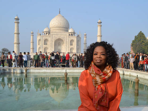 US talk show host Oprah Winfrey poses in front of the Taj Mahal on January 19, 2012. Photo: STRDEL, AFP/Getty Images / 2012 AFP