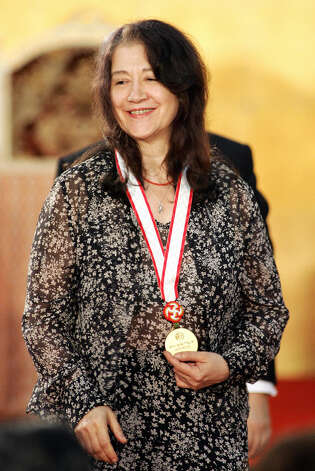 Argentinian pianist Martha Argerich smiles after receiving the gold medal of the Praemium Imperiale at the awarding ceremony in Tokyo, 18 October 2005. A major talent for 50 years. Photo: YOSHIKAZU TSUNO, AFP/Getty Images / 2005 AFP