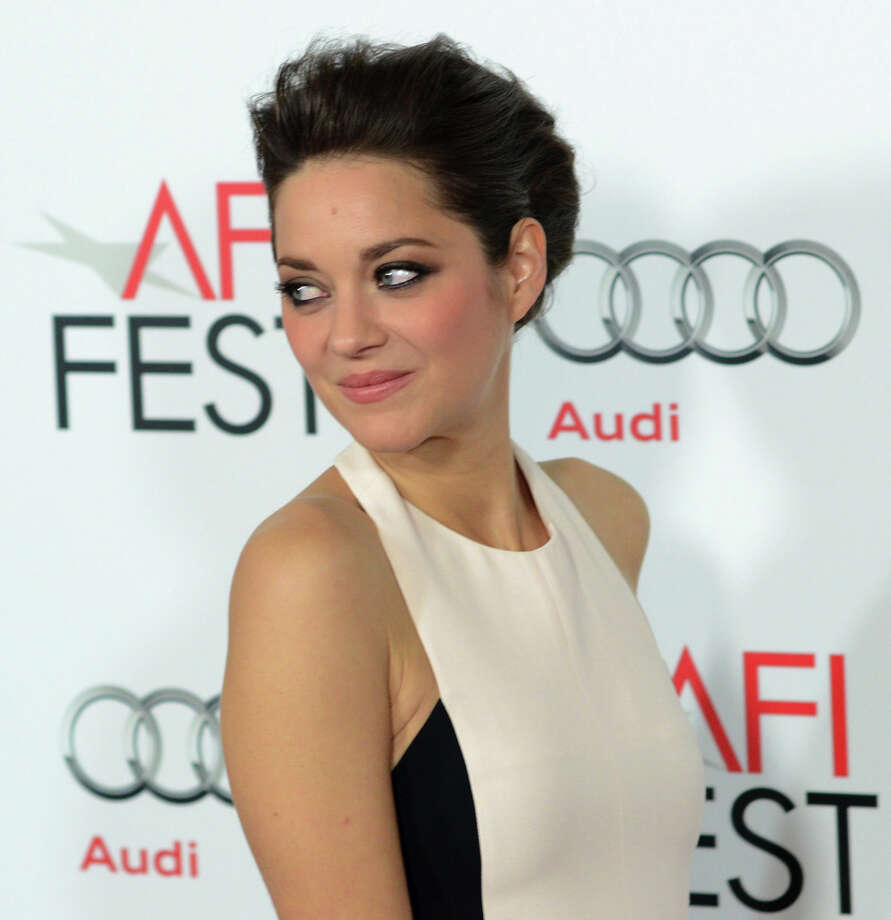 Actress Marion Cotillard arrives at the premiere of 'Rust and Bone.'  She is doing the best work of her life. (JOE KLAMAR/AFP/Getty Images) Photo: JOE KLAMAR, AFP/Getty Images / 2012 AFP