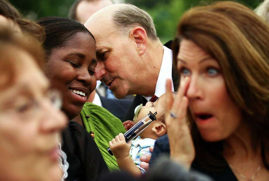WASHINGTON - JULY 21:  U.S. Rep. Louie Gohmert (R-TX) (2nd R) shares a moment with Tea Party member Danielle Hollars (2nd L) of Woodbridge, Virginia, and her nine-month-old son Damian during a news conference after the first meeting of the newly formed Tea Party Caucus on Capitol Hill July 21, 2010 in Washington, DC.  About two dozens of congressional members met with Tea Party members to discuss the party's concerns about the nation. Photo: Alex Wong, Getty Images / Getty Images North America