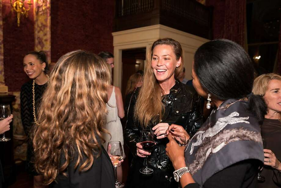 Actress Connie Nielsen chats with other partygoers. Photo: Drew Altizer Photography