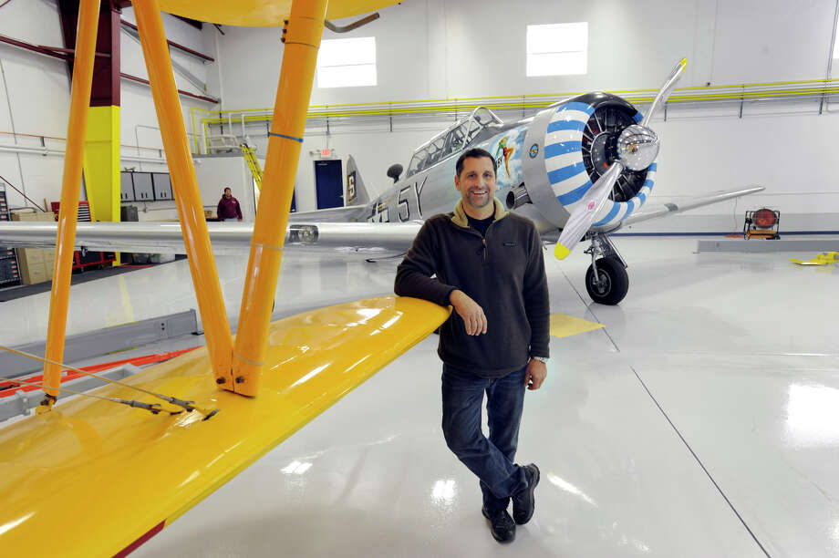 Chris Orifici of South Salem, N.Y., is the owner of Westconn Aviation in Danbury. He is photographed with two of his vintage planes, Friday, Nov. 30, 2012.  Orifici wants to add a restaurant to his business and says he is being blocked by city officials. Photo: Carol Kaliff / The News-Times