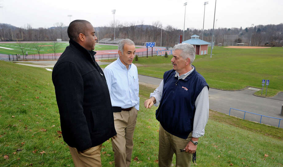 From left, Franz Warren and Michael Diker of the Danbury Youth Soccer Club, speak with Danbury High School Athletic Director Chip Salvestrini in front of some of the high school's playing fields, Friday, Nov. 30, 2012. Photo: Carol Kaliff / The News-Times