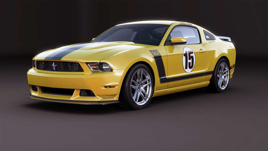 2013 Mustang Boss 302 Laguna Seca: Ford Mustang Boss 302 is back for more in 2013 with a new reflective hockey stick graphics package, which is the first modern application on a  production vehicle. 2013 Boss 302 and Boss Laguna Seca models feature new School Bus Yellow paint, honoring Parnelli Jones 1970 Trans-Am championship car prepared by Bud Moore. Photo: Ford Motor Company