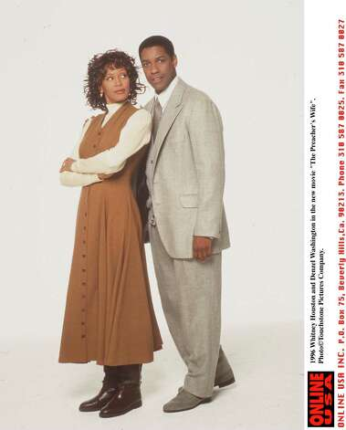 "Denzel Washington in 1996, in the movie ""The Preachers Wife"" with Whitney Houston (not a Ridley Scott movie).  Photo: Touchstone Pictures, Getty Images / Getty Images North America"