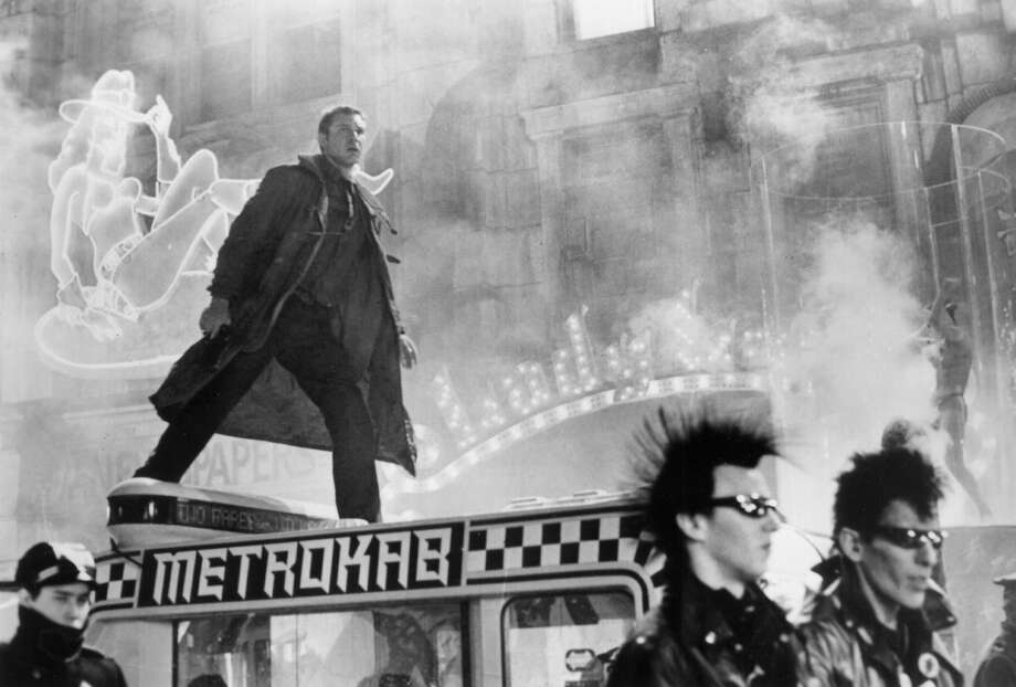 """Blade Runner,"" in which Ford starred as former cop Rick Deckard in pursuit of rebel Androids, showcased Scott's style in making visually striking, exotic and atmospheric movies.  Photo: UNKNOWN"