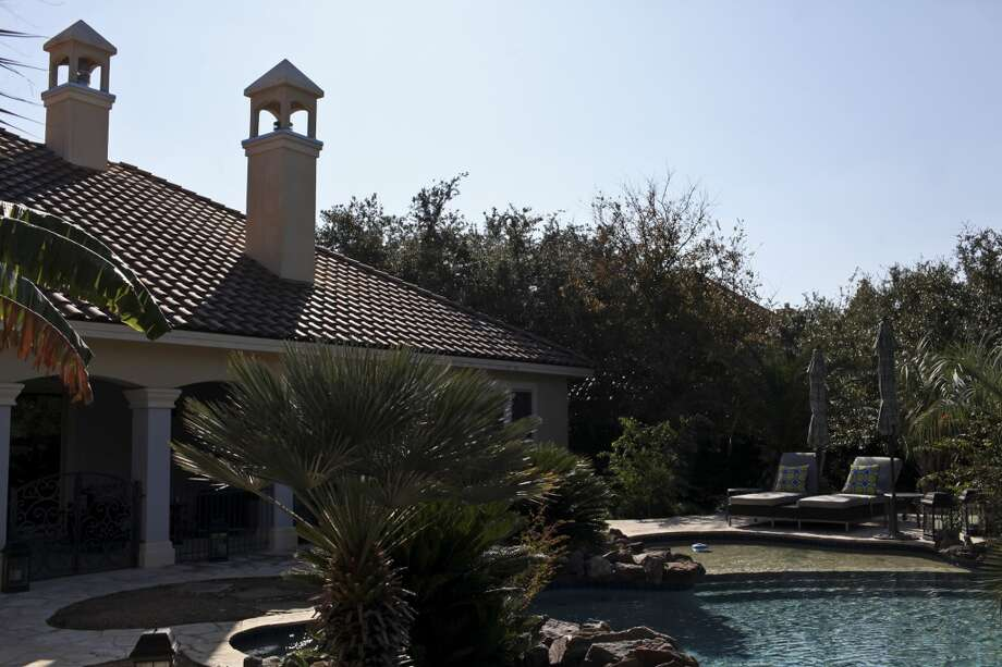 The pool behind the home of Reema and Naveen Kella in San Antonio on Wednesday, Nov. 28, 2012. (San Antonio Express-News)