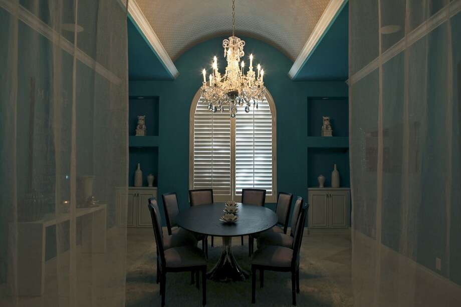 The dining room in the home of Reema and Naveen Kella in San Antonio on Wednesday, Nov. 28, 2012. (San Antonio Express-News)