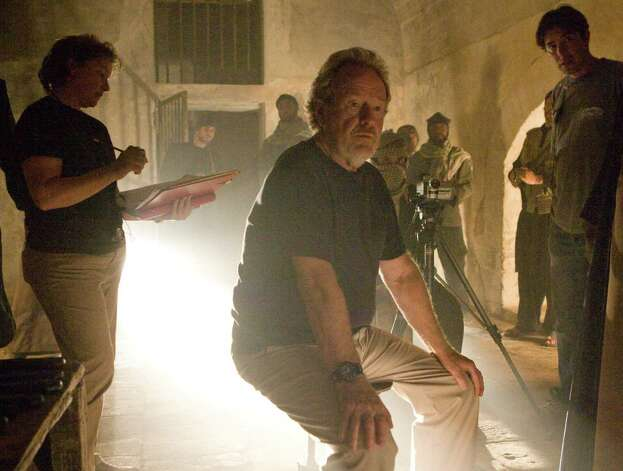 "Here's Ridley Scott directing his 2008 spy/terrorism movie ""Body of Lies,"" which starred Russell Crowe and Leonardo DiCaprio.  Photo: François Duhamel / ©2008 Warner Bros. Entertainment Inc._All Rights Reserved"