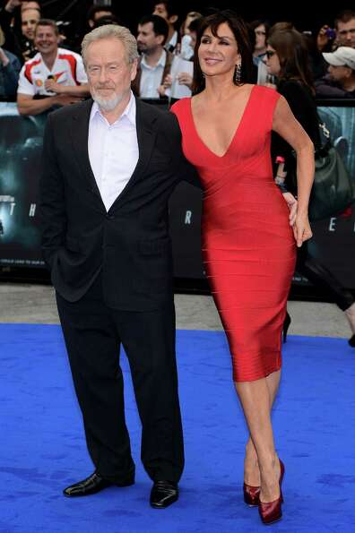 Sir Ridley Scott in 2012 with Gianina Facio at the premiere of