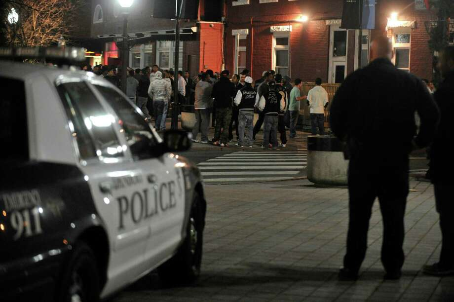 Danbury Police watch over a crowd on Ives Street as the bars close for the night early Friday morning, Nov. 30, 2012. Photo: Jason Rearick / The News-Times