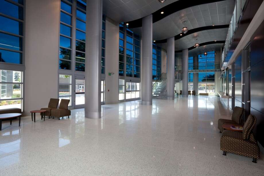 These two photos show how a glass featuring tints that adjust according to how much light is entering the building look with minimal and more intense tints. The glass manufactured by Sage Electrochromics Inc., was installed at Chabot College in Hayward, Calif. (Courtesy photo)