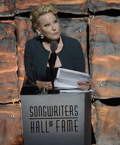 Lifetime Achievement Award inductee Bette Midler accepts her award at the 2012 Songwriters Hall of Fame induction and awards gala at the Marriott Marquis Hotel, Thursday June 14, 2012 in New York. (Photo by Evan Agostini/Invision) Photo: Evan Agostini / 2012 Invision