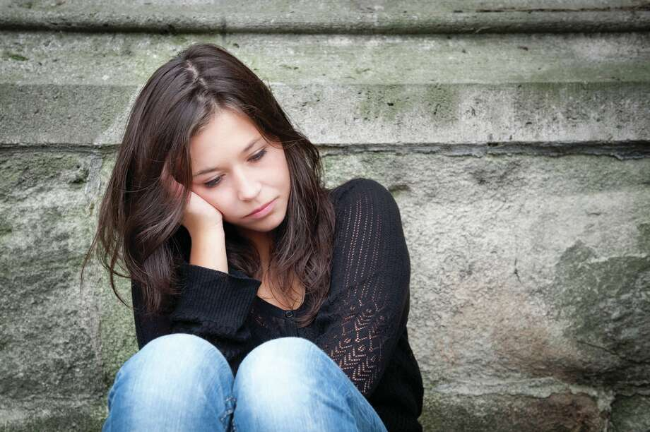 Teen depression is tough to deal with. (Fotolia.com) / Jochen Schönfeld - Fotolia