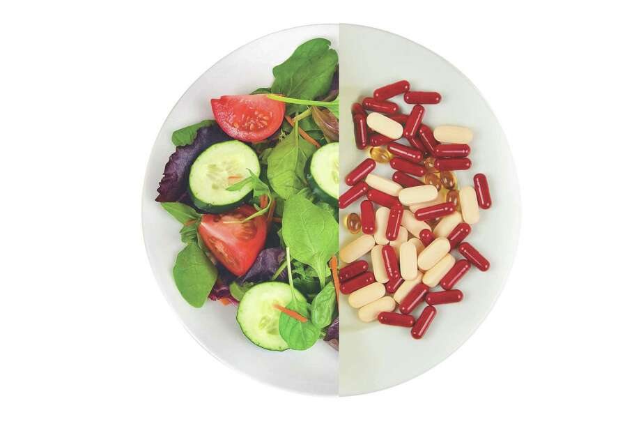 Which is better: Food or vitamin? (Times Union illustration) / Darren Brode  02/13/10