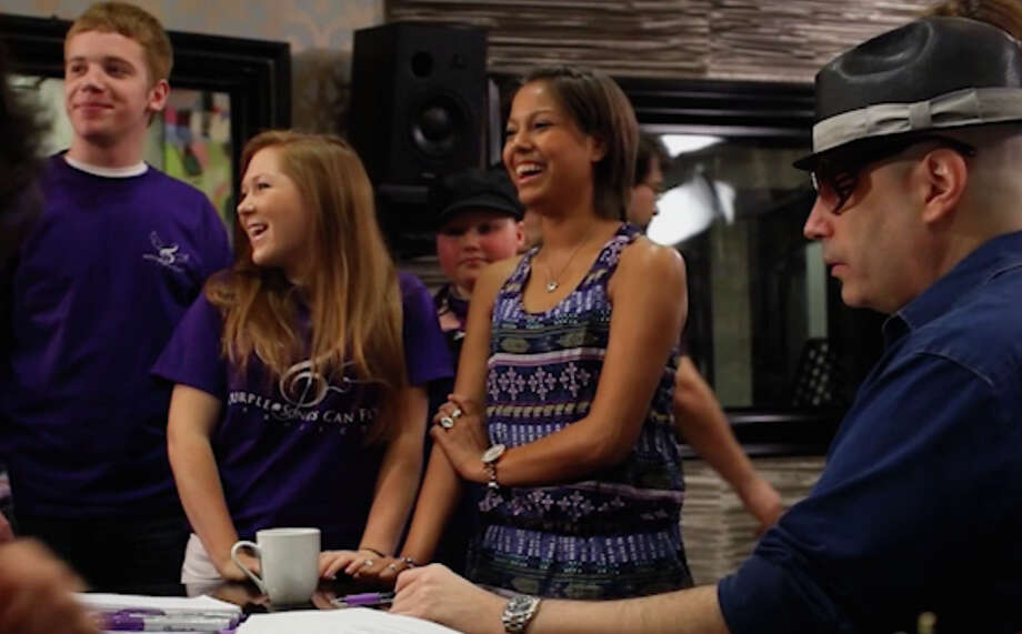 Kids and teens from nonprofit Purple Songs Can Fly, who have written songs during their cancer treatment, wrote and recorded a song with a team of professional musicians at ZapBoomBang Studios. Photo: --