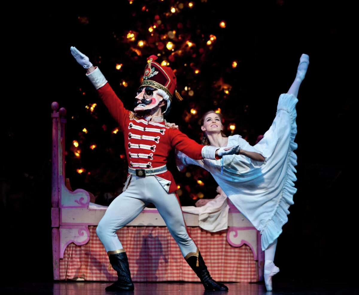 """Allison Miller and William Newton dance in """"The Nutcracker,"""" choreographed by Ben Stevenson, with music by Pyotr Ilyich Tchaikovsky."""