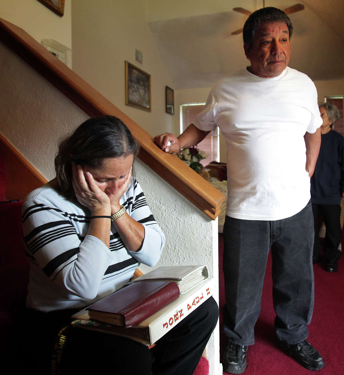 Maria Beltran, left, grieves for her son Jose Beltran, 31, and her grandson Eli Beltran, 3, who were killed after they were hit by a car, walking along Foster Rd. near I-10. Ricardo Espinoza, Jose's step father, is at right. Friday, Nov. 30, 2012.