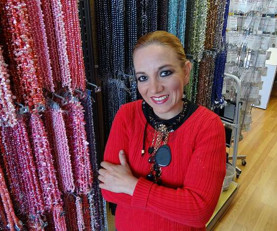 Gina Tello of Beading 2 Go is optimistic about Mexico's new president, Enrique Peña Nieto. She said that, because he is a member of the old ruling party once known for corruption, he will be eager to show that the PRI has reformed. Photo: Billy Calzada, San Antonio Express News / San Antonio Express News
