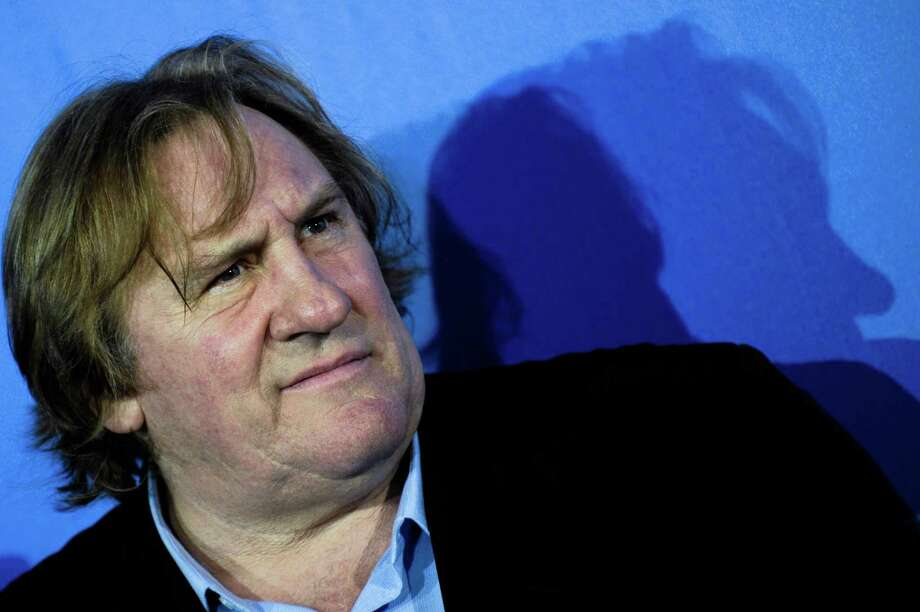 FILE - French actor Gerard Depardieu poses at a photo-call of the film 'Mammuth' in Berlin, Germany, in this file photo dated Friday, Feb. 19, 2010. The 63-year old French actor Gerard Depardieu was detained Thursday Nov. 29, 2012, for allegedly driving drunk and falling off his scooter in Paris, according to news reports quoting police sources. (AP Photo/Kai-Uwe Knoth, File) Photo: Kai-Uwe Knoth