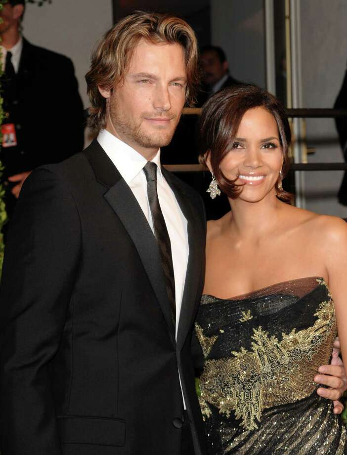 FILE - In this Feb. 22, 2009 file photo, model Gabriel Aubry, left, and actress Halle Berry arrive at the Vanity Fair Oscar party in West Hollywood, Calif. Attorneys for Halle Berry and her ex-boyfriend, Aubry, have settled court issues that arose after a Nov. 22, 2012 Thanksgiving Day fight at the actress' home. (AP Photo/Evan Agostini, File) Photo: Evan Agostini
