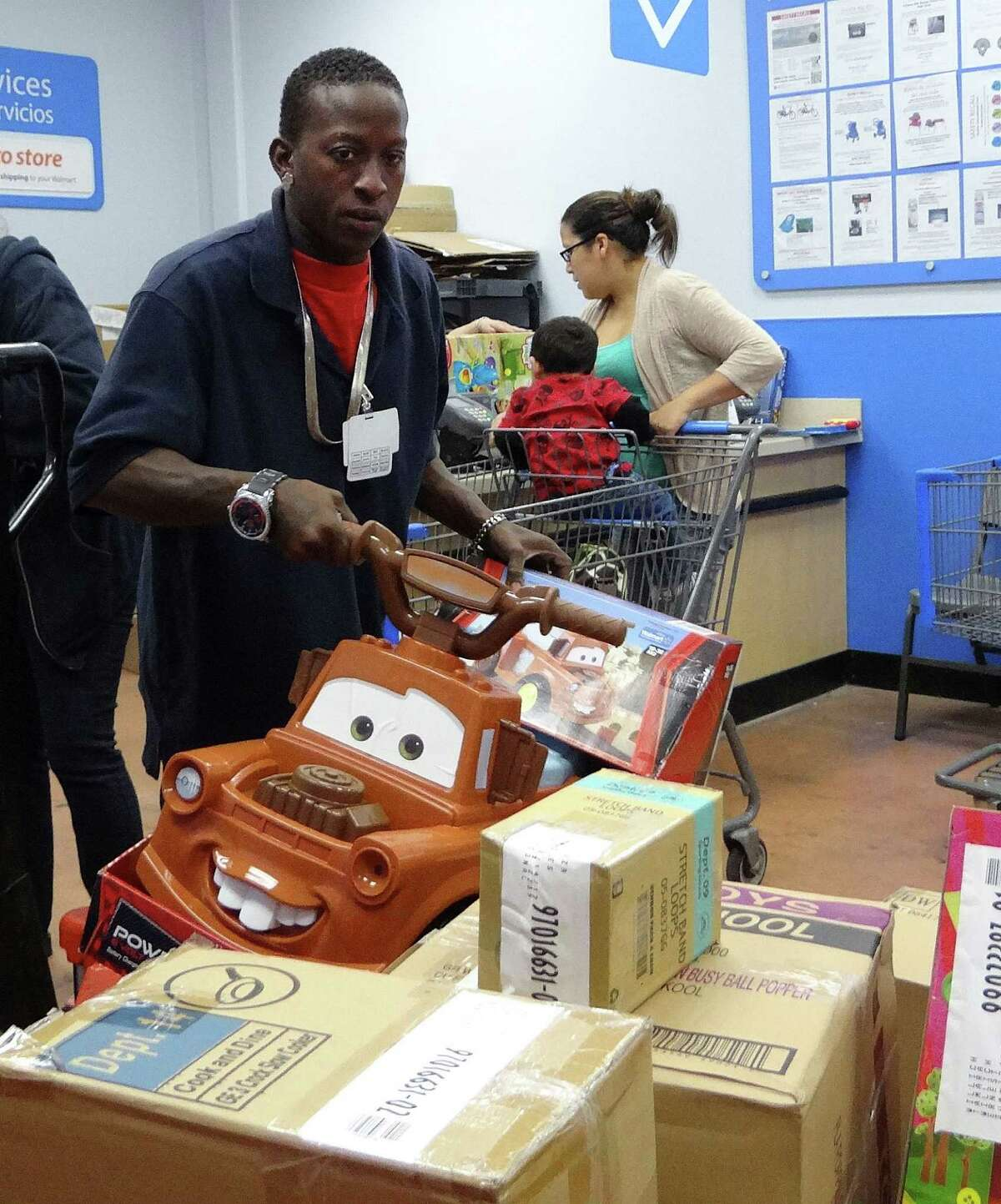 Walter Carmichael pulls merchandise in the layaway department of the West Military Drive WalMart on Friday, Nov. 30, 2012.