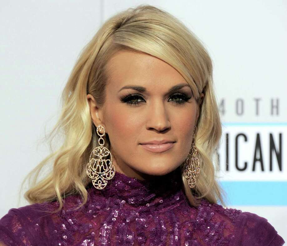 "FILE - In this Sunday, Nov. 18, 2012 file photo, Carrie Underwood arrives at the 40th Anniversary American Music Awards in Los Angeles. Underwood will star in NBC's live broadcast of ""The Sound of Music"" late next year, according to a news release Friday, Nov. 30, 2012. (Photo by Jordan Strauss/Invision/AP, File) Photo: Jordan Strauss"