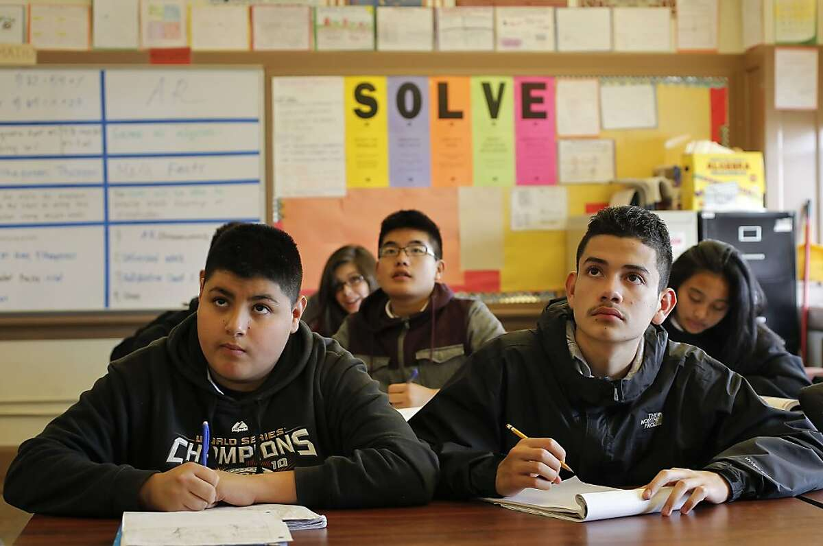 (l to r) Oscar Flores, Jacob Wong and Melvin Chavez during algebra class at James Denman Middle School.