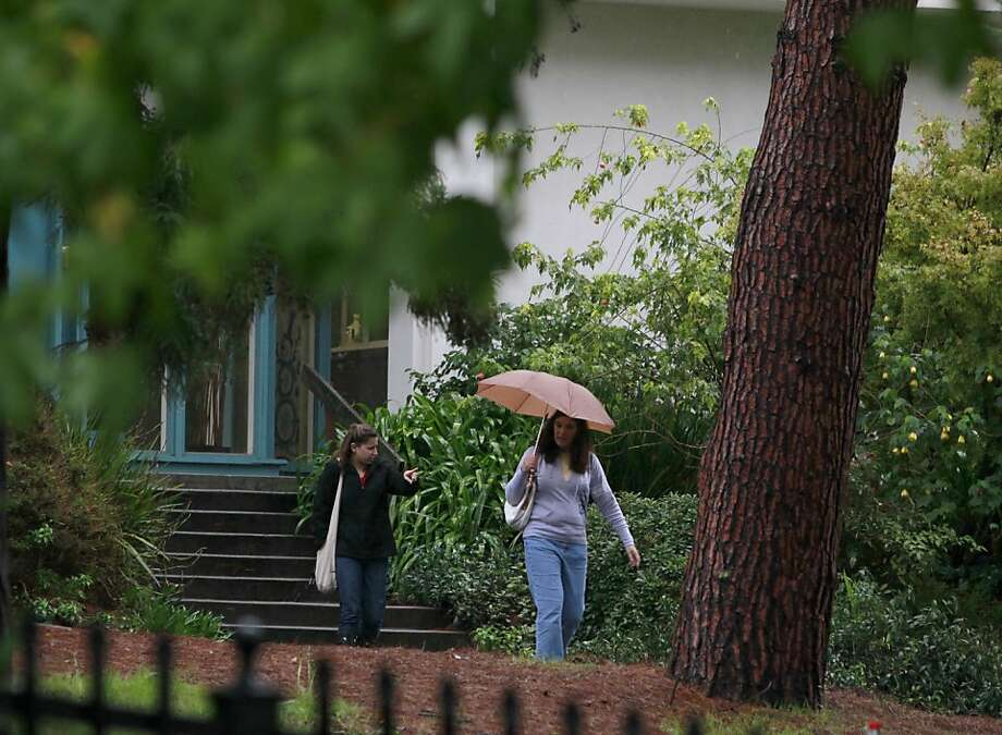 Women walk on the grounds of the Fred Finch Youth Center in Oakland, Calif. on Friday, Nov. 30, 2012. A supsect was arrested Monday in the severe beating of a 16-year-old autistic girl who walked away from the facility last week. Photo: Paul Chinn, The Chronicle