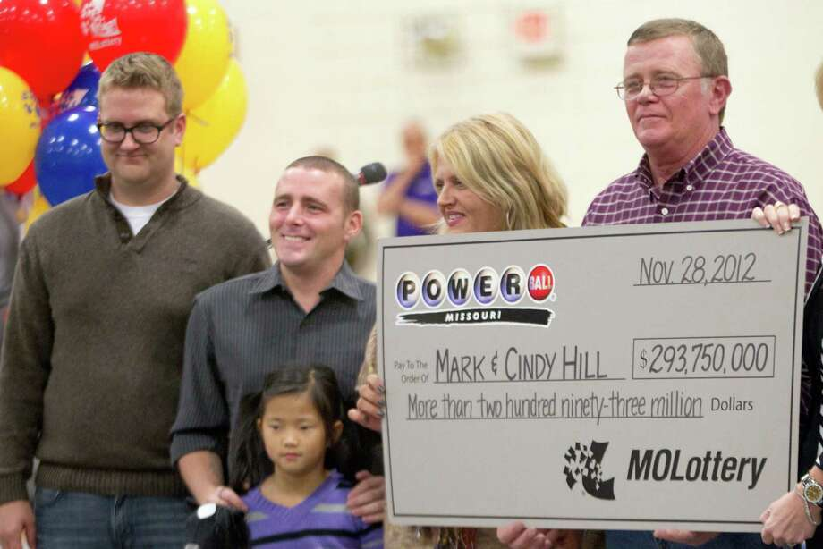 5. $587.5 million, Powerball, Nov. 28, 2012 (2 tickets from Arizona and Missouri)Missouri winners Mark and Cindy Hill hold a Powerball check with three of their four children,  Jarod, left, Cody and Jaiden in Dearborn, Mo., Friday, Nov. 30, 2012. Photo: Orlin Wagner, STF / AP