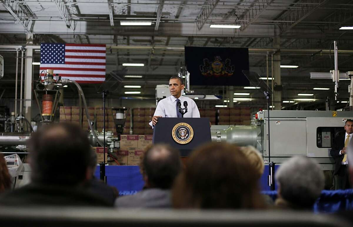 """HATFIELD, PA - NOVEMBER 30: U.S. President Barack Obama speaks at The Rodon Group manufacturing facility on November 30, 2012 in Hatfield, Pennsylvania. Obama made a case for action on """"fiscal cliff"""" legislation and urged congress to work together for a solution. (Photo by Jessica Kourkounis/Getty Images)"""