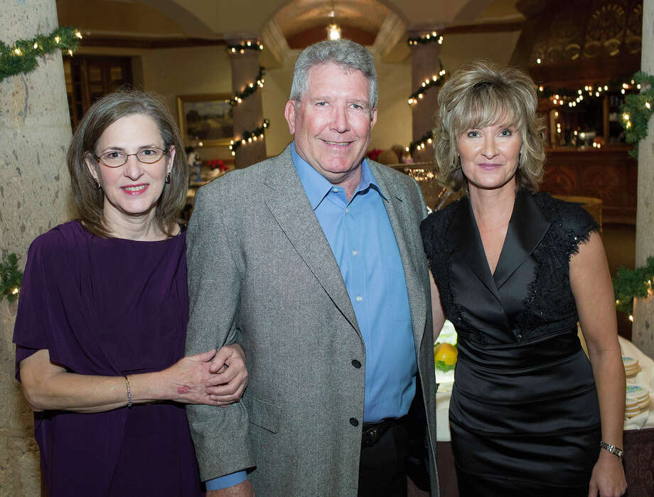 SpaySA board President Pepi Klecka (from left), board member John Herbold  and Executive President Cathy McCoy get together at the SpaySA Casino  Night fundraiser at The Dominion Country Club. Photo: J.  Michael Short, For The Express-News / THE SAN ANTONIO EXPRESS-NEWS