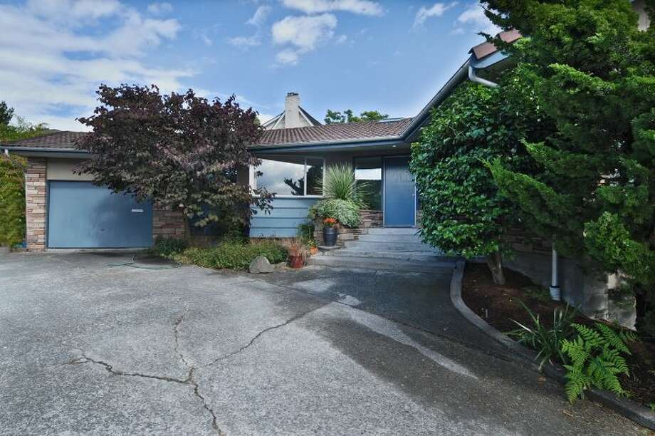 Front of 3512 N.W. 70th St. The 3,440-square-foot house, built in 1953, has four bedrooms, 2.5 bathrooms, high ceilings, skylights, French doors, a family room, a bar and a patio on a 6,420-square-foot lot. It's listed for $839,000. Photo: Courtesy Lee Whalen/Windermere Real Estate