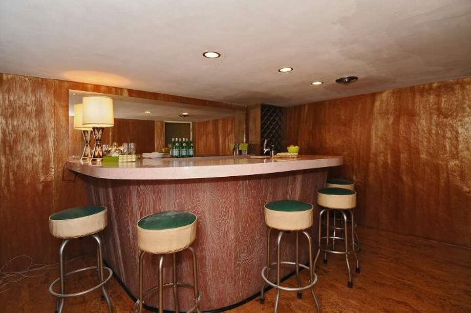 Bar of 3512 N.W. 70th St. The 3,440-square-foot house, built in 1953, has four bedrooms, 2.5 bathrooms, high ceilings, skylights, French doors, a family room and a patio on a 6,420-square-foot lot. It's listed for $839,000. Photo: Courtesy Lee Whalen/Windermere Real Estate